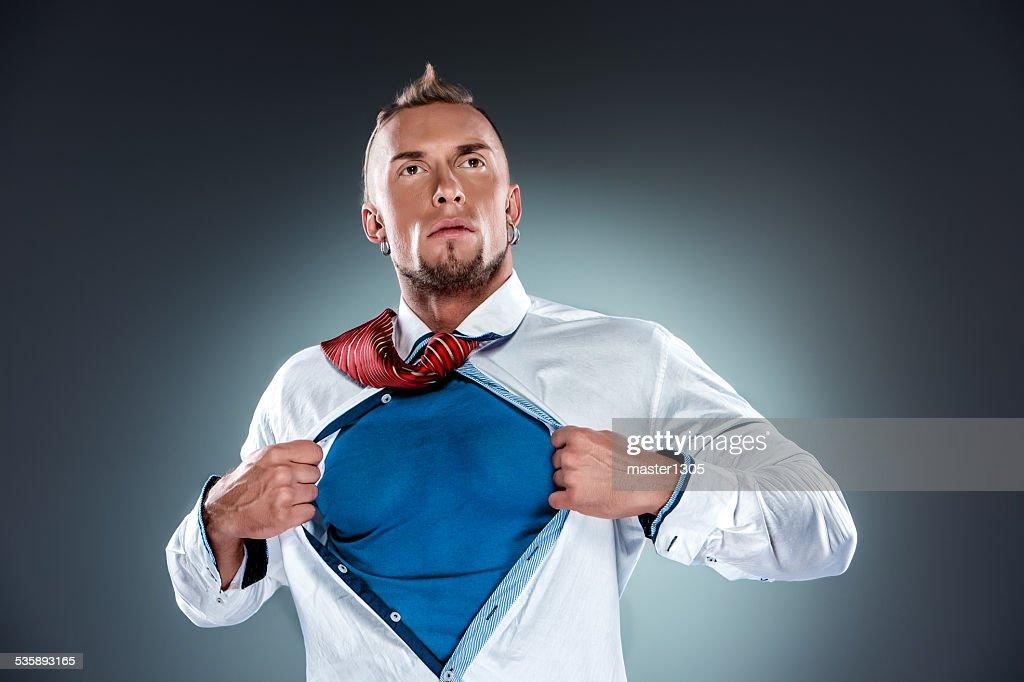 businessman acting like a super hero and tearing his shirt : Stock Photo