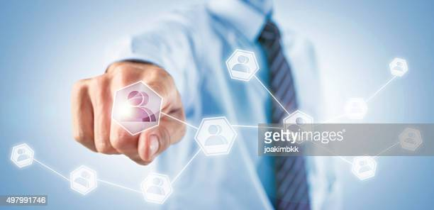 businessman adding social friends on his network - people icons stock pictures, royalty-free photos & images