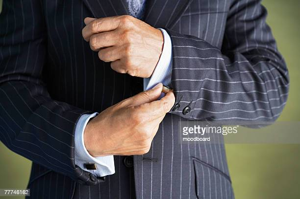Businessman Adjusting Cuff Links