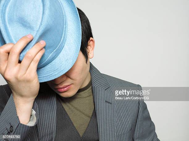 Businessman adjusting his hat