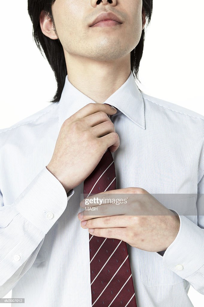 Businessman Adjusting His Tie : Stock Photo