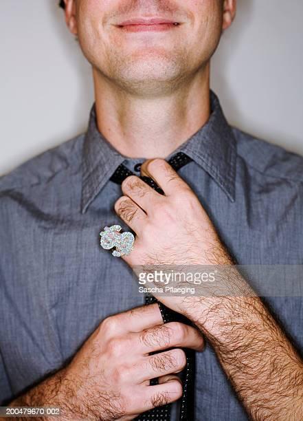 Businessman adjusting tie, close-up