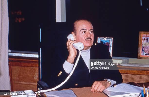 Businessman Adnan Khashoggi at his desk in his office at Olympic Tower in New York USA 1986