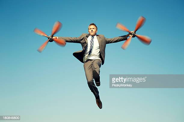 Businessman Adventurer Flying with Airplane Propellers Blue Sky