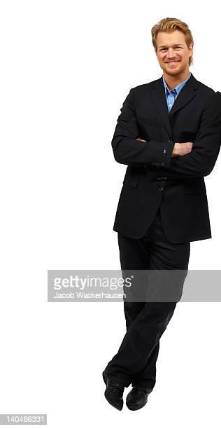 Geschäftsmann vor einem weißen Hintergrund.