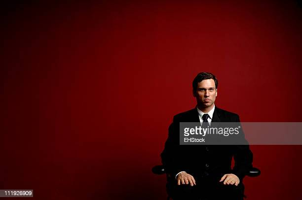 Businessman against Red Wall Negative Space