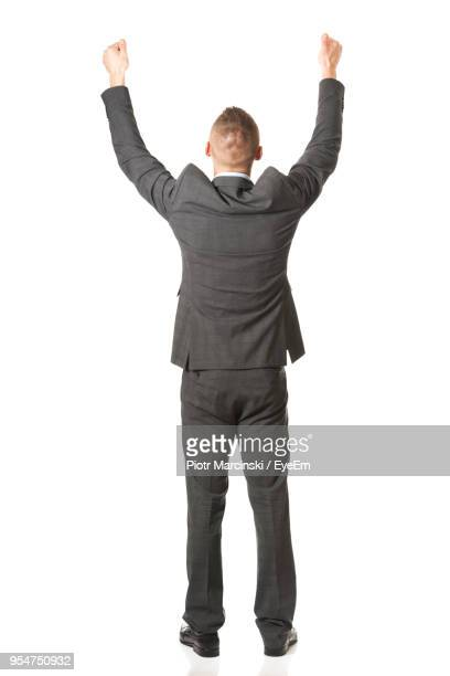 businessman against white background - arms raised stock pictures, royalty-free photos & images