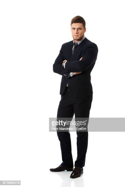 businessman against white background - black suit stock pictures, royalty-free photos & images