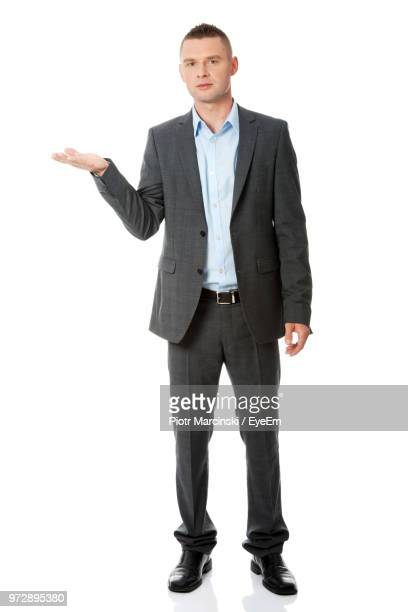 businessman against white background - grey suit stock pictures, royalty-free photos & images