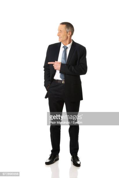 businessman against white background - anzug stock-fotos und bilder
