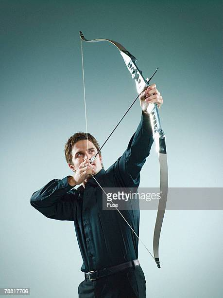 Businessman Aiming a Bow