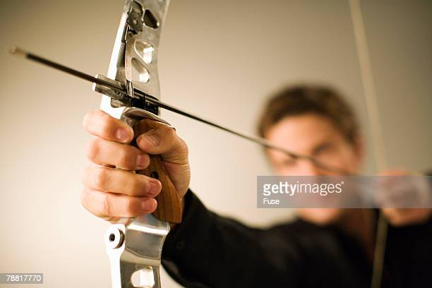 Businessman Aiming an Arrow