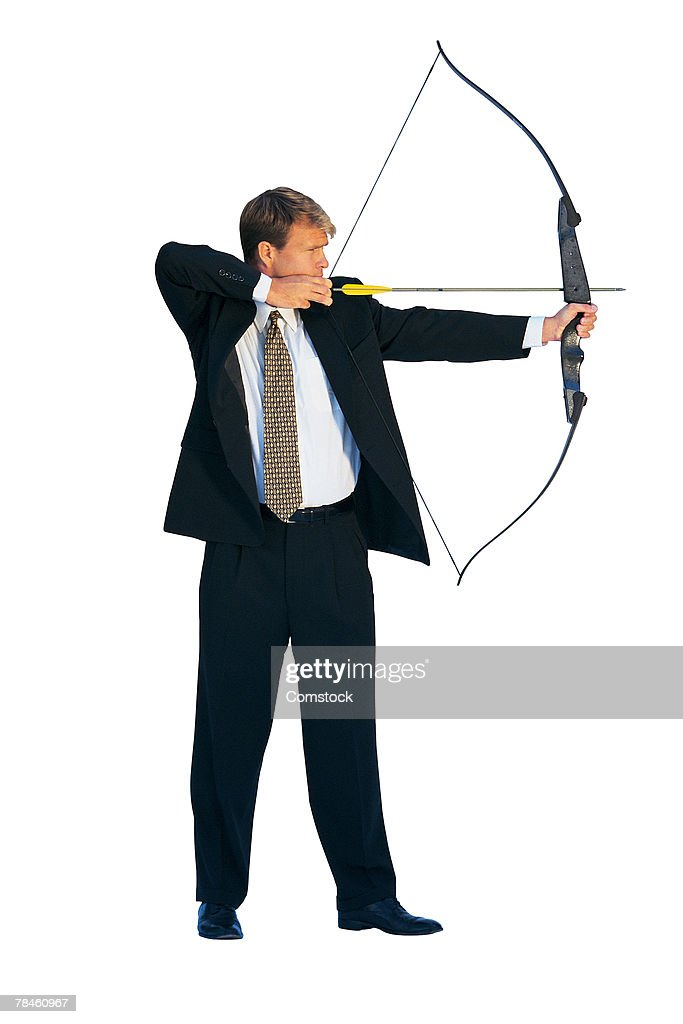 Businessman aiming bow and arrow : Stock Photo