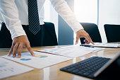 Businessman analyse investment marketing data.