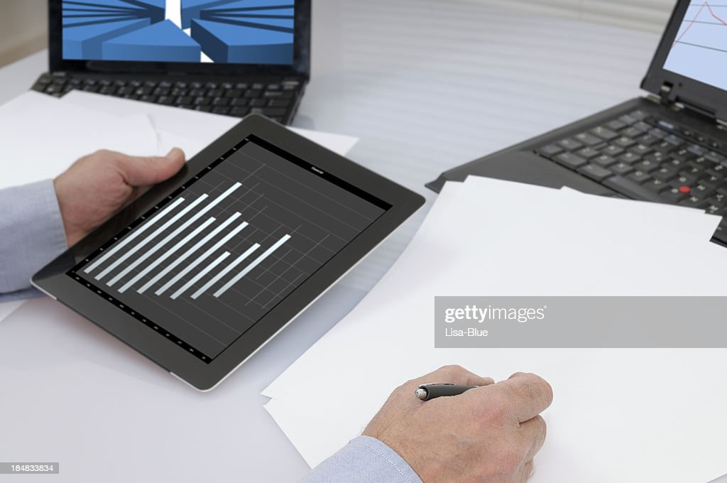 Businessman Analysing Graph on Digital Tablet PC : Stock Photo