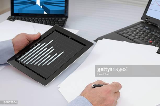 Businessman Analysing Graph on Digital Tablet PC
