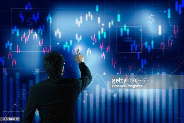 Businessman analysis finance diagram. and business graph on a touch screen interface