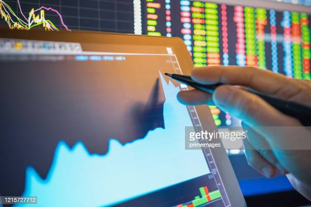 businessman analysis stock chart in crisis covid-19 for investment in stockmarket and finance business planning selective stock for stockmarket crash and financial crisis - economy stock pictures, royalty-free photos & images