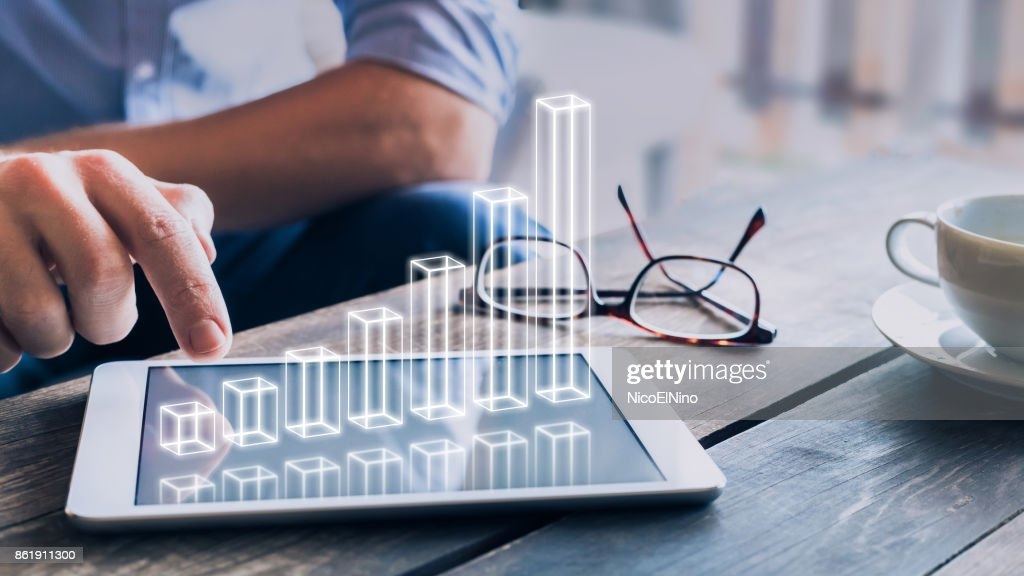 Businessman analyzing growing 3D AR chart above tablet computer screen : Foto de stock