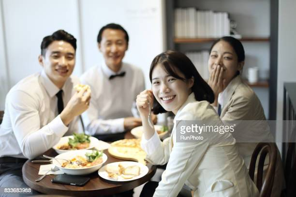 businessman and a business woman who is eating pleasantly