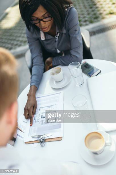 Businessman and business woman are working outdoor