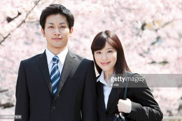 businessman and business woman in front of cherry blossoms - number of people stock photos and pictures