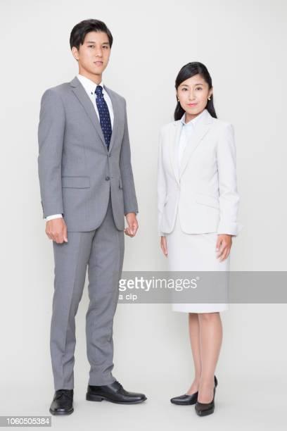 ビジネスマンとビジネスウーマン - 全身 ストックフォトと画像