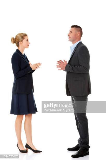 businessman and businesswoman against white background - heterosexual couple stock pictures, royalty-free photos & images