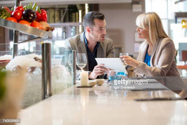 Businessman and businesswoman at lunch in restaurant