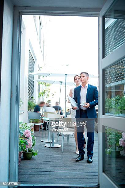 Businessman and businesswoman at outdoor cafe