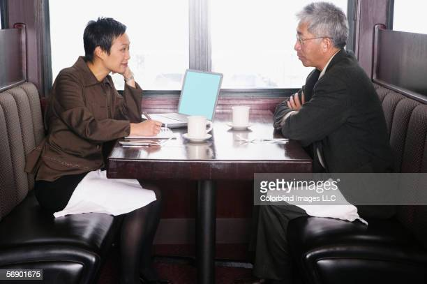 Businessman and businesswoman dining