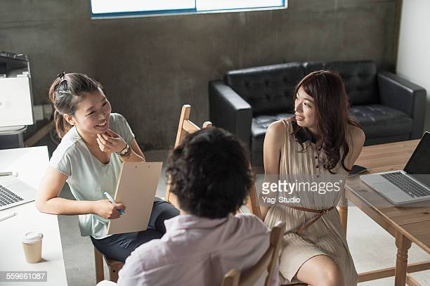 Businessman and businesswoman discussing project