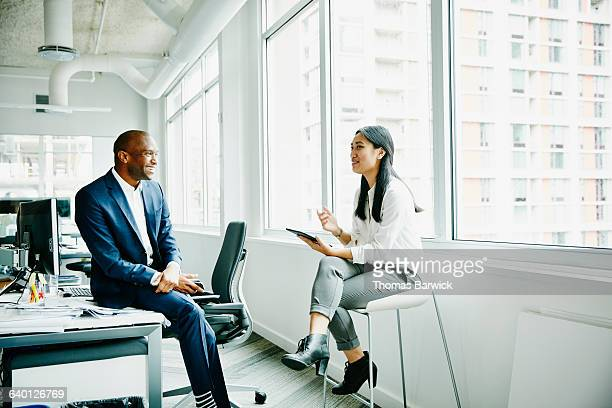 businessman and businesswoman discussing project - two people stock pictures, royalty-free photos & images