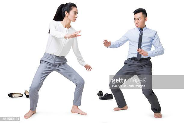 businessman and businesswoman fighting - face off sports play stock photos and pictures