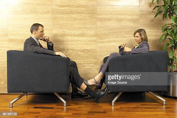 businessman and businesswoman flirting - playing footsie stock pictures, royalty-free photos & images