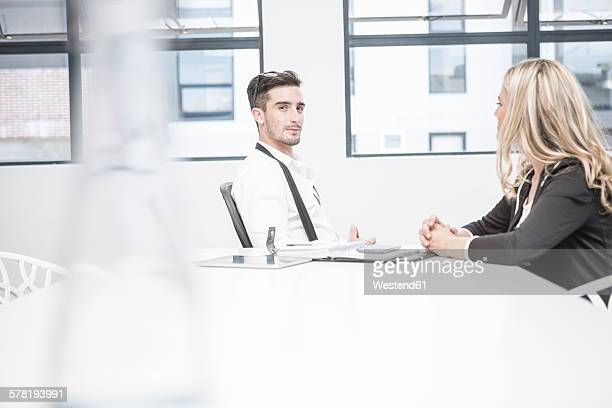 Businessman and businesswoman having an office meeting