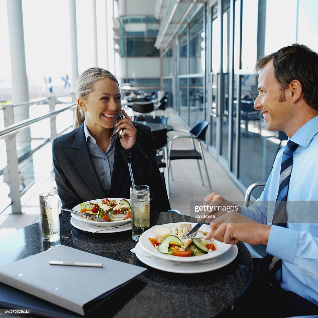 Businessman and businesswoman having lunch : Stock Photo