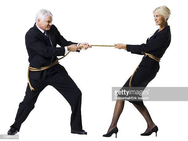 Businessman and businesswoman in a tug of war