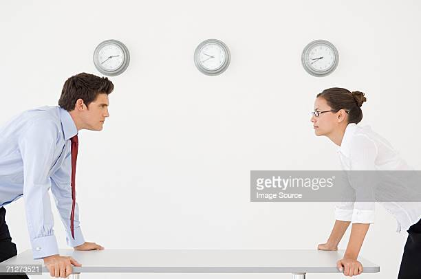 Businessman and businesswoman in an argument