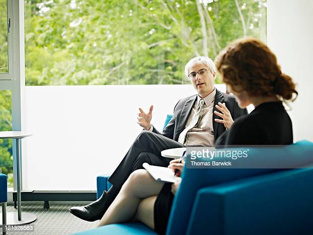 Businessman and businesswoman in discussion