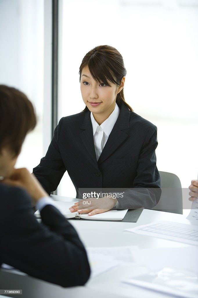 Businessman And Businesswoman In Meeting, Head and Shoulder, Front View, Rear View,  : Photo