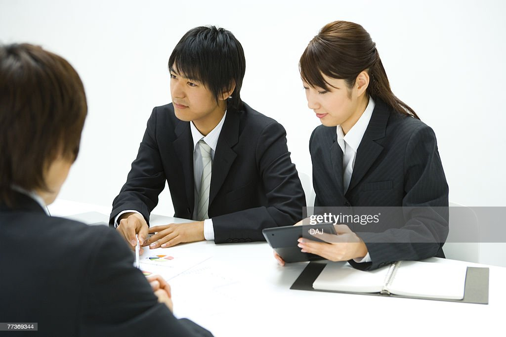 Businessman and Businesswoman In Meeting, Side View : Photo