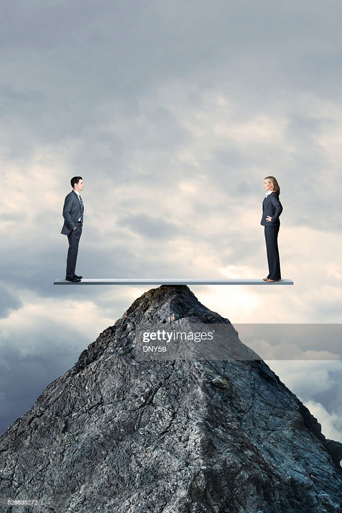 Businessman And Businesswoman In Perfect Balcance On Seesaw On MountaintopBusinessman And Businesswoman : Stock Photo