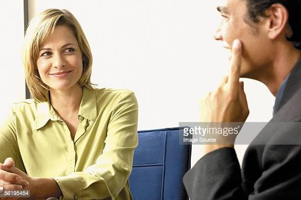 Businessman and businesswoman joking