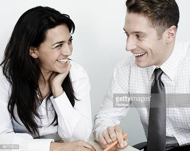 Businessman and businesswoman laughing