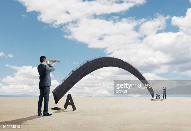 businessman and businesswoman look through spyglass for shortest distance between two points - letra b imagens e fotografias de stock