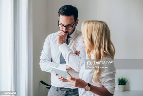 businessman and businesswoman on a meeting - contemplation couple stock pictures, royalty-free photos & images
