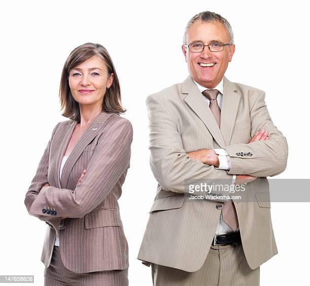 Businessman and businesswoman smiling against white background