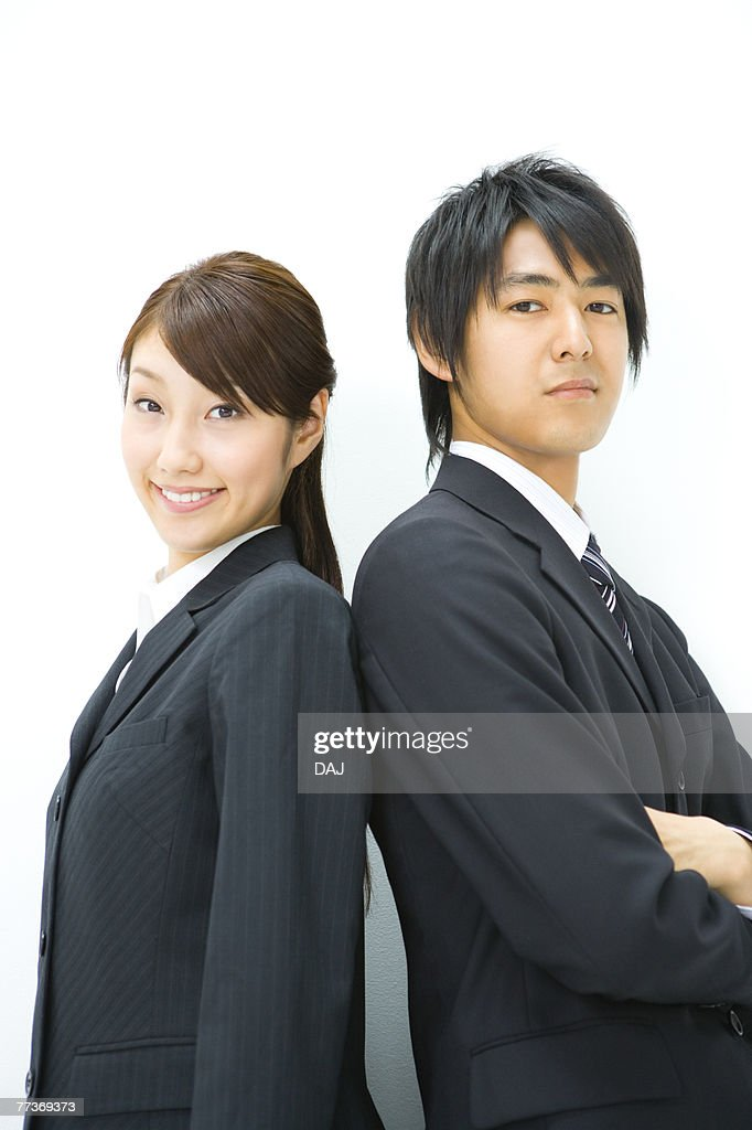 Businessman And Businesswoman Standing Back To Back, Side View, Waist Up, : Photo