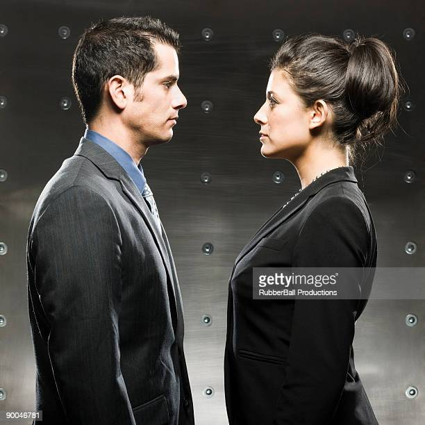 businessman and businesswoman standing face to face